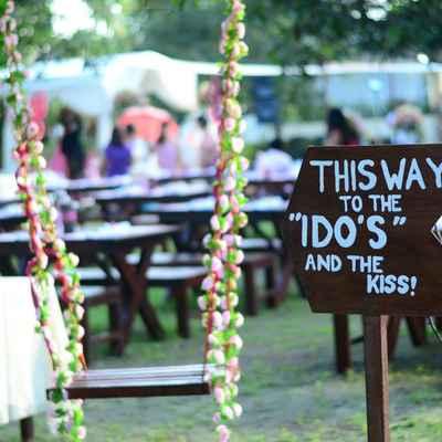 Outdoor brown wedding signs