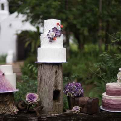 Outdoor purple wedding cupcakes