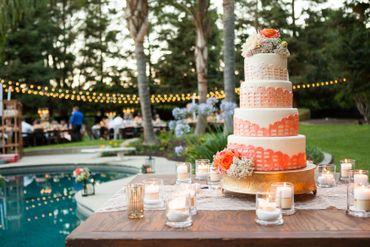Outdoor orange wedding reception decor