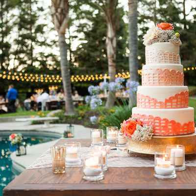 Outdoor orange wedding reception decor