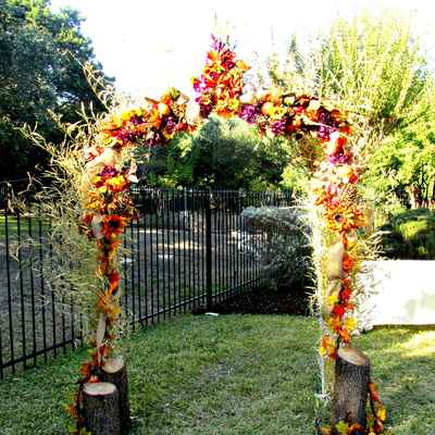 Outdoor autumn yellow wedding ceremony decor