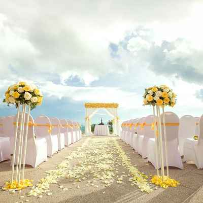 Outdoor yellow wedding ceremony decor