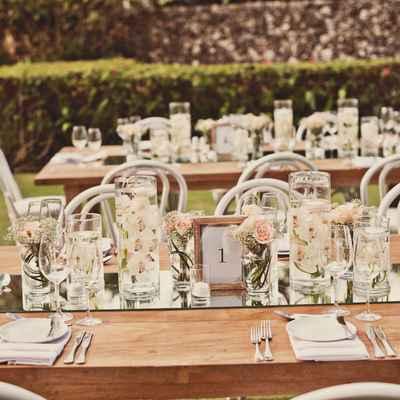 Outdoor ivory wedding reception decor