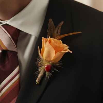 Orange wedding buttonhole