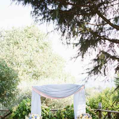Outdoor blue wedding ceremony decor