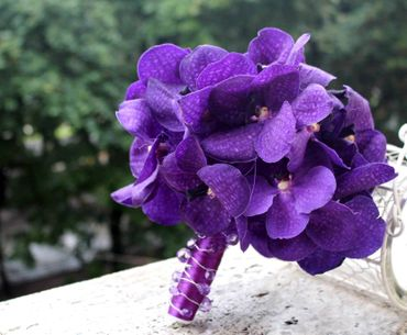 Purple orchid wedding bouquet